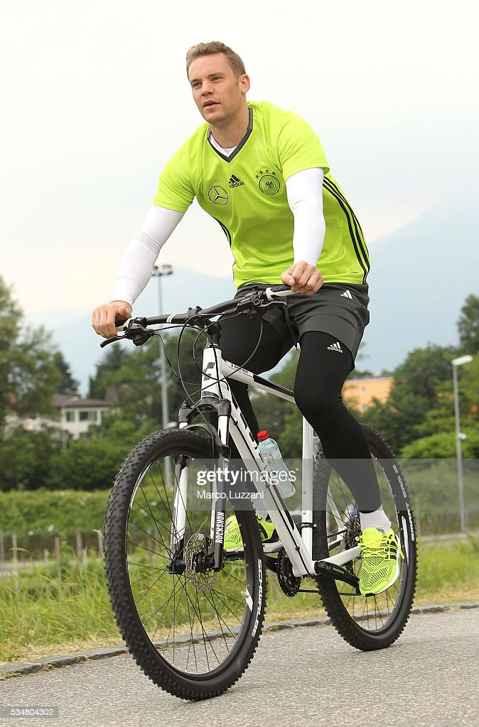 <a gi-track='captionPersonalityLinkClicked' href=/galleries/search?phrase=Manuel+Neuer&family=editorial&specificpeople=764621 ng-click='$event.stopPropagation()'>Manuel Neuer</a> of Germany arrives by bicycle at the German national team's pre-EURO 2016 training camp on May 28, 2016 in Ascona, Switzerland.