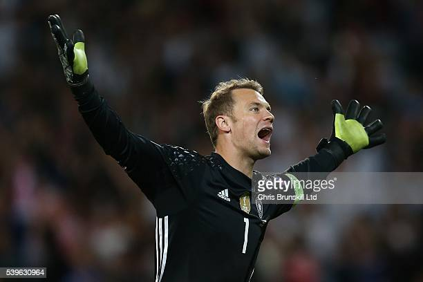 Manuel Neuer of Germany celebrates his side's second goal during the UEFA Euro 2016 Group C match between Germany and Ukraine at Stade PierreMauroy...