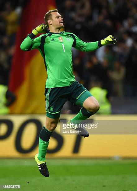 Manuel Neuer of Germany celebrates his teams third goal scored by Mario Goetze of Germany during the EURO 2016 Qualifier Group D match between...