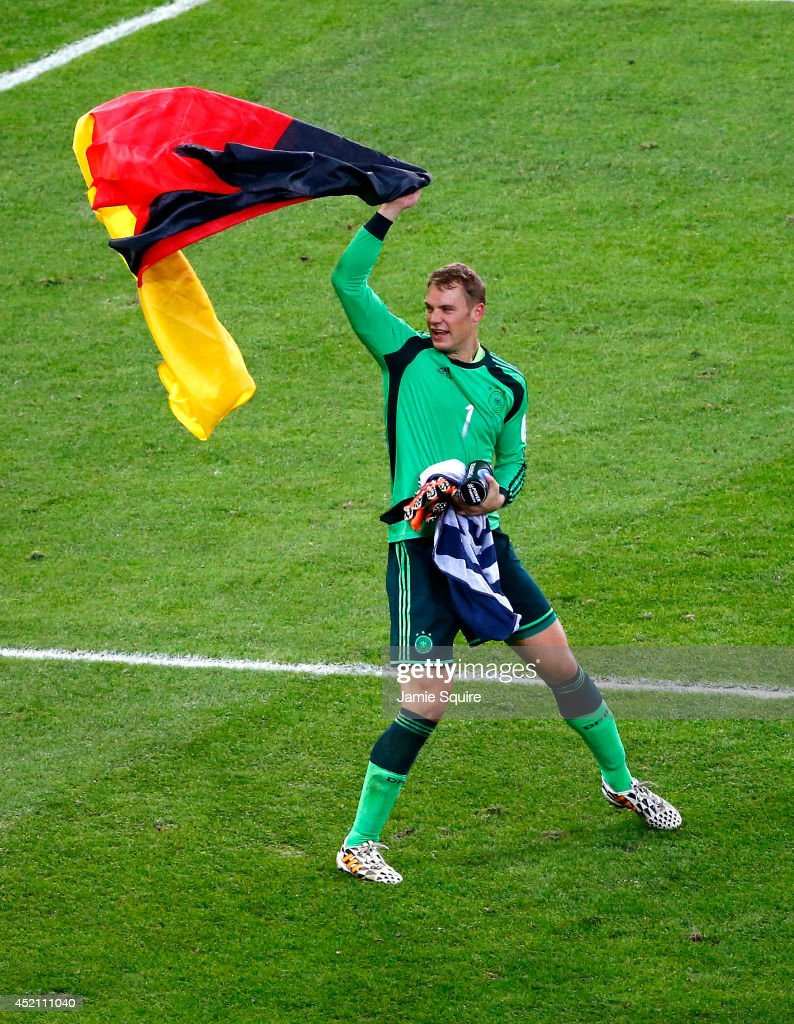 <a gi-track='captionPersonalityLinkClicked' href=/galleries/search?phrase=Manuel+Neuer&family=editorial&specificpeople=764621 ng-click='$event.stopPropagation()'>Manuel Neuer</a> of Germany celebrates with a German flag after defeating Argentina 1-0 in extra time during the 2014 FIFA World Cup Brazil Final match between Germany and Argentina at Maracana on July 13, 2014 in Rio de Janeiro, Brazil.