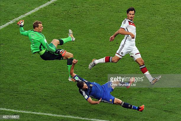 Manuel Neuer of Germany clashes with Gonzalo Higuain of Argentina during the 2014 World Cup Final match between Germany and Argentina at Maracana...