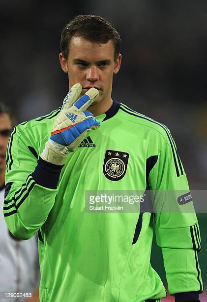 Manuel Neuer of Germany in action during the UEFA EURO 2012 Group A qualifying match between Germany and Belgium at EspritArena on October 11 2011 in...