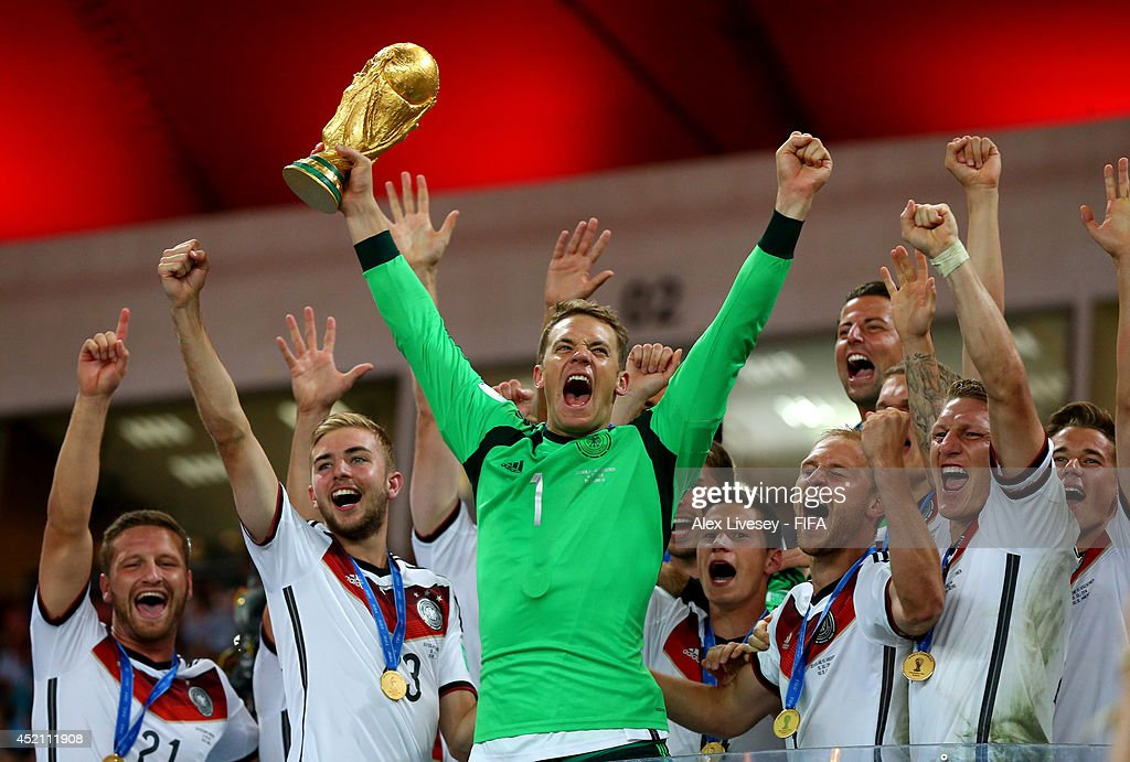 <a gi-track='captionPersonalityLinkClicked' href=/galleries/search?phrase=Manuel+Neuer&family=editorial&specificpeople=764621 ng-click='$event.stopPropagation()'>Manuel Neuer</a> of Germany lifts the World Cup to celebrate with his teammates during the award ceremony after the 2014 FIFA World Cup Brazil Final match between Germany and Argentina at Maracana on July 13, 2014 in Rio de Janeiro, Brazil.