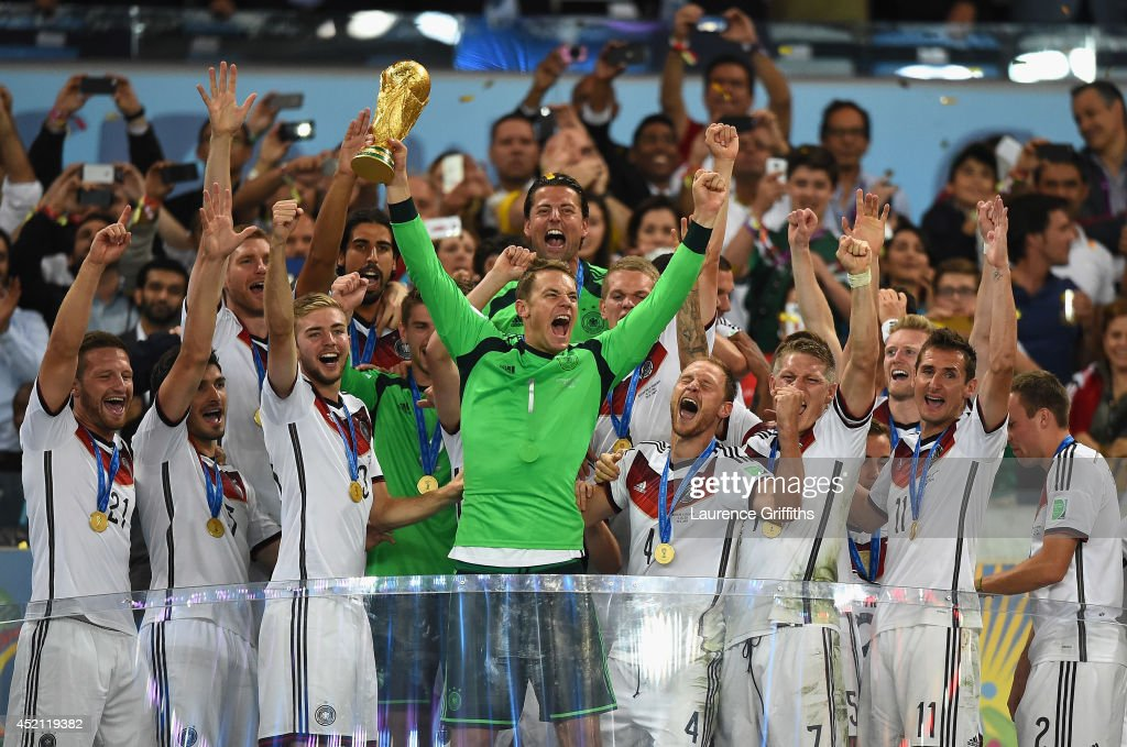 Manuel Neuer of Germany lifts the World Cup trophy with his team after defeating Argentina 1-0 in extra time during the 2014 FIFA World Cup Brazil Final match between Germany and Argentinaat Maracana on July 13, 2014 in Rio de Janeiro, Brazil.