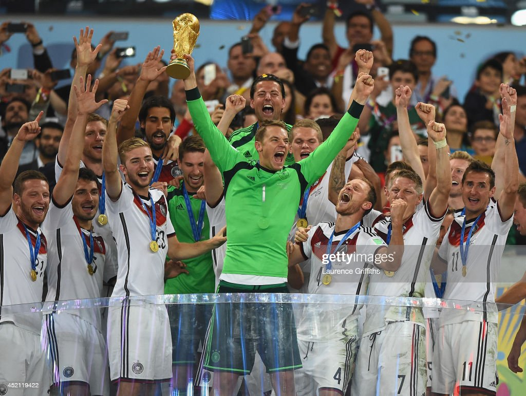 <a gi-track='captionPersonalityLinkClicked' href=/galleries/search?phrase=Manuel+Neuer&family=editorial&specificpeople=764621 ng-click='$event.stopPropagation()'>Manuel Neuer</a> of Germany lifts the World Cup trophy with his team after defeating Argentina 1-0 in extra time during the 2014 FIFA World Cup Brazil Final match between Germany and Argentinaat Maracana on July 13, 2014 in Rio de Janeiro, Brazil.
