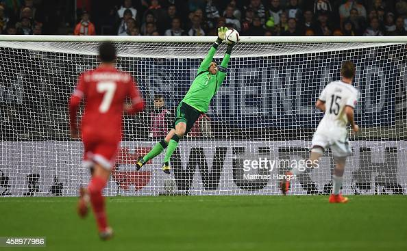 Manuel Neuer of Germany makes his first save of the match late in the first half during the EURO 2016 Group D Qualifier match between Germany and...