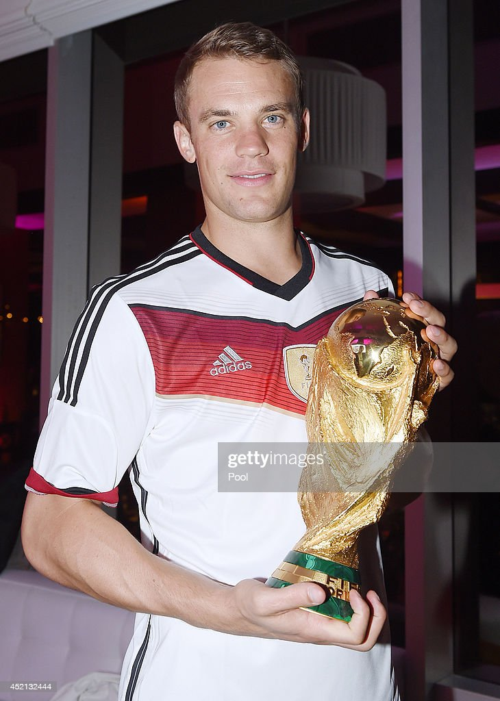 <a gi-track='captionPersonalityLinkClicked' href=/galleries/search?phrase=Manuel+Neuer&family=editorial&specificpeople=764621 ng-click='$event.stopPropagation()'>Manuel Neuer</a> of Germany poses with the World Cup as he celebrates with teammates at a party after winning the 2014 FIFA World Cup Brazil Final match against Argentina, at Sheraton Hotel on July 13, 2014 in Rio de Janeiro, Brazil.