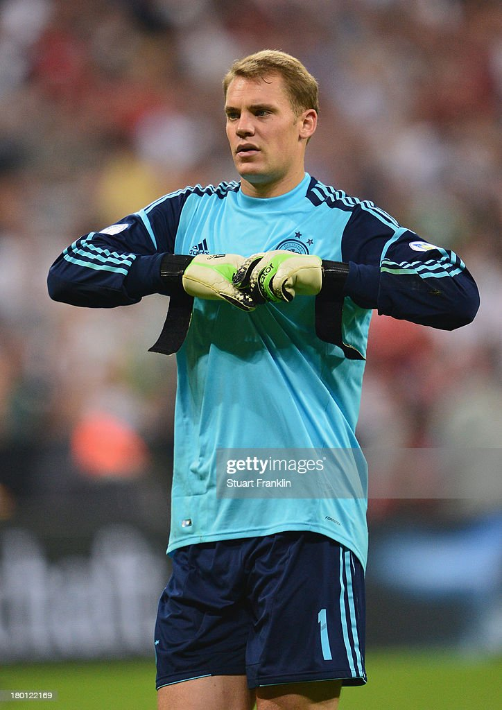 <a gi-track='captionPersonalityLinkClicked' href=/galleries/search?phrase=Manuel+Neuer&family=editorial&specificpeople=764621 ng-click='$event.stopPropagation()'>Manuel Neuer</a> of Germany pulls off his gloves during the FIFA 2014 world cup qualifier match between Germany and Austria at the Allianz Arena on September 6, 2013 in Munich, Germany.