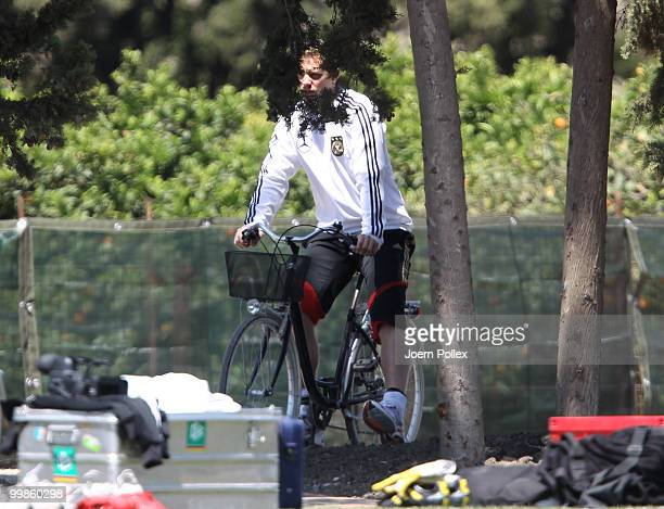 Manuel Neuer of Germany rides a bike prior to the German National Team training session at Verdura Golf and Spa Resort on May 18 2010 in Sciacca Italy