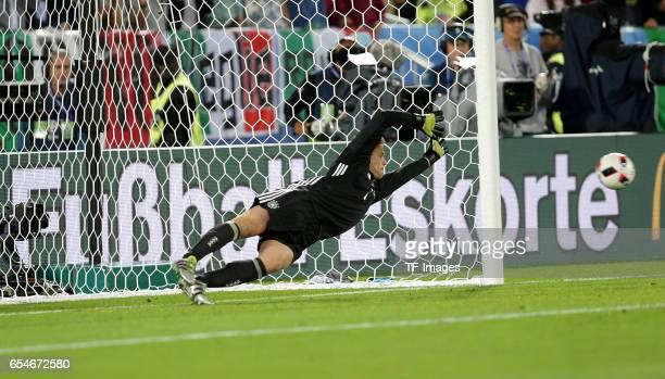Manuel Neuer of Germany saves a penalty from Leonardo Bonucci of Italy during the UEFA EURO 2016 quarter final match between Germany and Italy at...