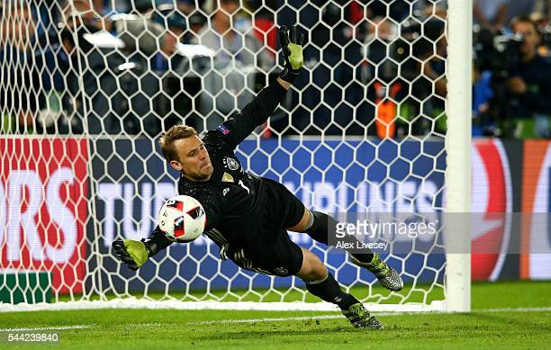 Manuel Neuer of Germany saves the penalty by Leonardo Bonucci of Italy at the penalty shootout during the UEFA EURO 2016 quarter final match between...