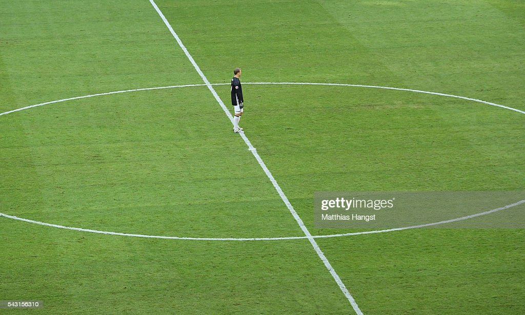<a gi-track='captionPersonalityLinkClicked' href=/galleries/search?phrase=Manuel+Neuer&family=editorial&specificpeople=764621 ng-click='$event.stopPropagation()'>Manuel Neuer</a> of Germany stands on the halfway line during the UEFA EURO 2016 round of 16 match between Germany and Slovakia at Stade Pierre-Mauroy on June 26, 2016 in Lille, France.