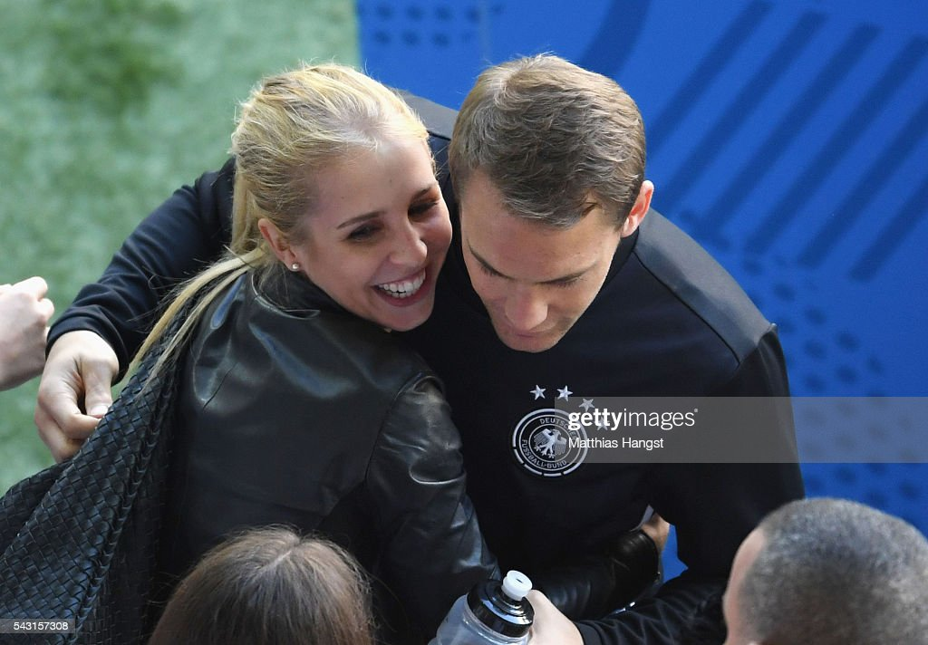 <a gi-track='captionPersonalityLinkClicked' href=/galleries/search?phrase=Manuel+Neuer&family=editorial&specificpeople=764621 ng-click='$event.stopPropagation()'>Manuel Neuer</a> of Germany talks his girlfriend Nina Weiss after the UEFA EURO 2016 round of 16 match between Germany and Slovakia at Stade Pierre-Mauroy on June 26, 2016 in Lille, France.