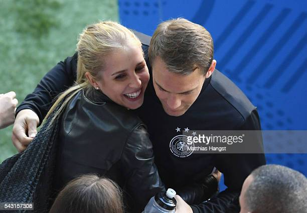 Manuel Neuer of Germany talks his girlfriend Nina Weiss after the UEFA EURO 2016 round of 16 match between Germany and Slovakia at Stade PierreMauroy...