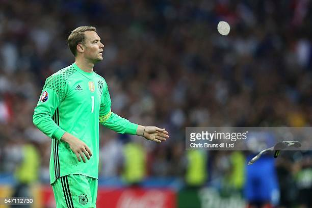 Manuel Neuer of Germany throws away his gloves at fulltime following the UEFA Euro 2016 Semi Final match between Germany and France at Stade...