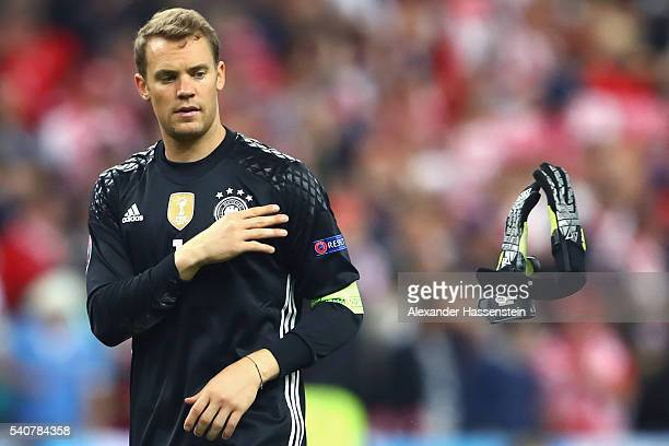 Manuel Neuer of Germany throws his goalkeeper gloves after his team's scoreless draw in the UEFA EURO 2016 Group C match between Germany and Poland...