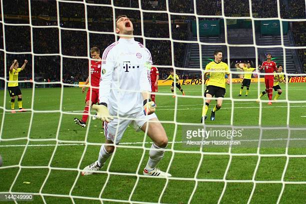 Manuel Neuer of Muenchen reacts after receiving the second goal during the DFB Cup final match between Borussia Dortmund and FC Bayern Muenchen at...