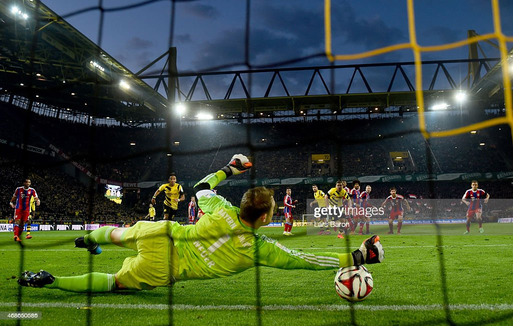 <a gi-track='captionPersonalityLinkClicked' href=/galleries/search?phrase=Manuel+Neuer&family=editorial&specificpeople=764621 ng-click='$event.stopPropagation()'>Manuel Neuer</a> of Muenchen saves a free kick of <a gi-track='captionPersonalityLinkClicked' href=/galleries/search?phrase=Marco+Reus&family=editorial&specificpeople=5445884 ng-click='$event.stopPropagation()'>Marco Reus</a> of Dortmund during the Bundesliga match between Borussia Dortmund and FC Bayern Muenchen at Signal Iduna Park on April 4, 2015 in Dortmund, Germany.