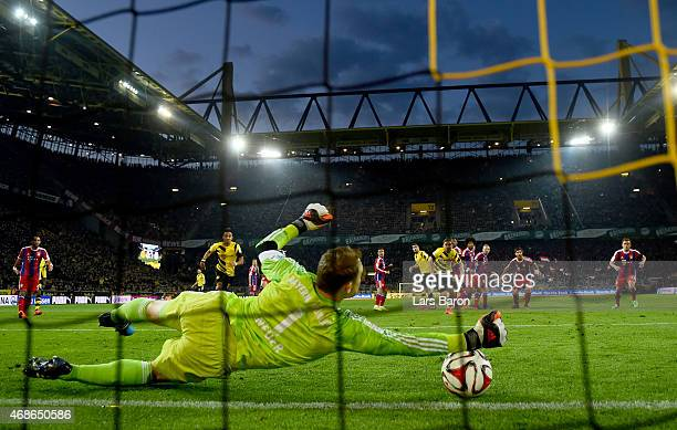 Manuel Neuer of Muenchen saves a free kick of Marco Reus of Dortmund during the Bundesliga match between Borussia Dortmund and FC Bayern Muenchen at...