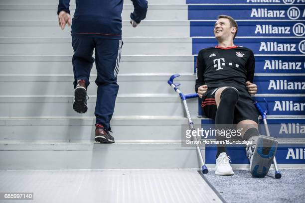 Manuel Neuer of Muenchen smiles as he sits in the player's tunnel after the Bundesliga match between Bayern Muenchen and SC Freiburg at Allianz Arena...