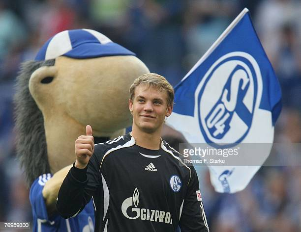 Manuel Neuer of Schalke celebrates with mascot Erwin during the Bundesliga match between Schalke 04 and Arminia Bielefeld at the Veltins Arena on...