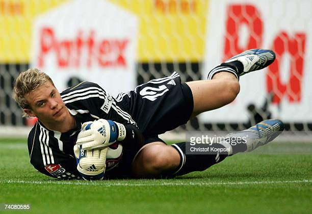 Manuel Neuer of Schalke makes a save during the Bundesliga match between Schalke 04 and 1FC Nuremberg at the Veltins Arena on May 5 2007 in...