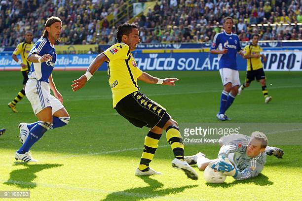 Manuel Neuer of Schalke saves the shoot of Lucas Barrios of Dortmund during the Bundesliga match between Borussia Dortmund and FC Schalke 04 at the...