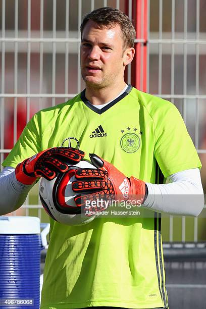 Manuel Neuer of the German national team looks on during a training session at Bayern Muenchen's trainings ground Saebener Strasse on November 11...
