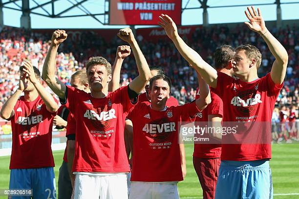 Manuel Neuer Philipp Lahm Thomas Mueller of Muenchen celebrate being Bundesliga champions after beating Ingolstadt 21 in the Bundesliga match between...