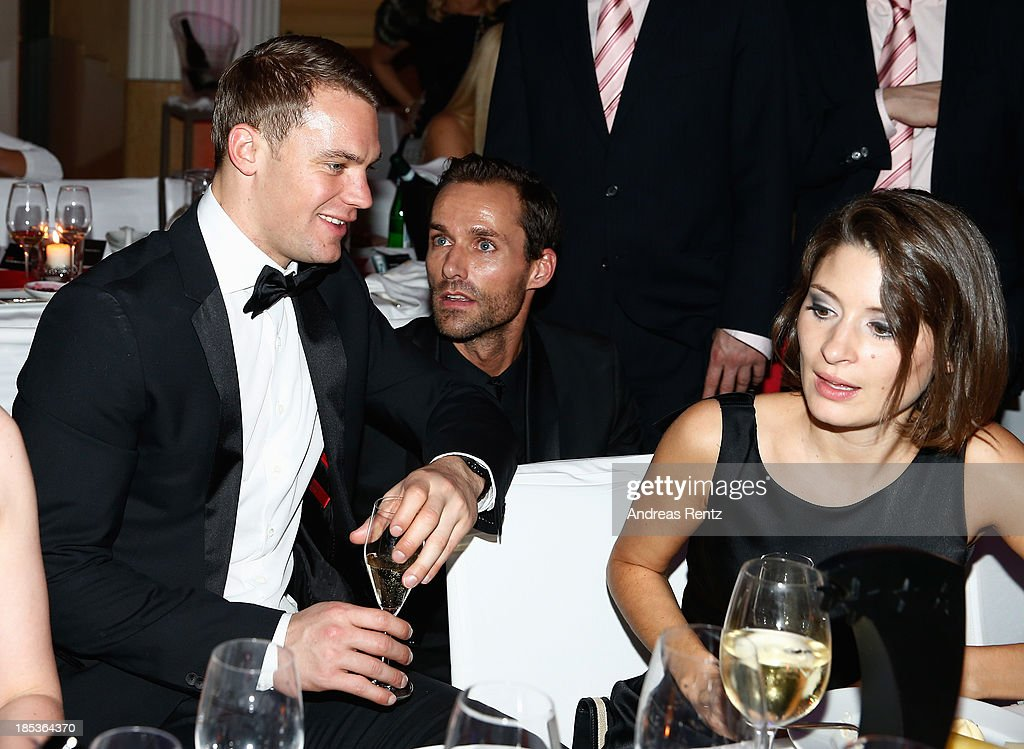 Manuel Neuer, Sven Hannawald and Kathrin Gilch attend the 7th Audi Generation Award 2013 at Hotel Bayerischer Hof on October 19, 2013 in Munich, Germany.