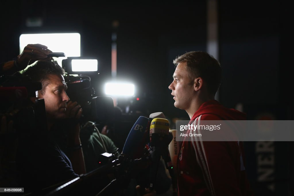 Manuel Neuer talks to journalists during the FC Bayern Muenchen Paulaner photo shoot in traditional Bavarian lederhosen on September 13, 2017 in Munich, Germany.
