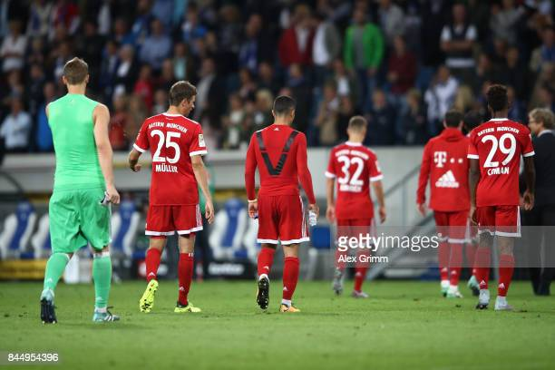 Manuel Neuer Thomas Mueller of Bayern Muenchen and other player of Bayern leave the pitch dejected during the Bundesliga match between TSG 1899...