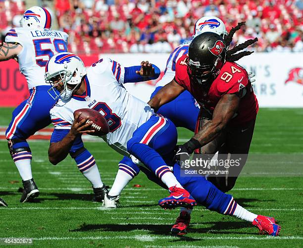Manuel of the Buffalo Bills is pressured by Adrian Clayborn of the Tampa Bay Buccaneers at Raymond James Stadium on December 8 2013 in Tampa Florida