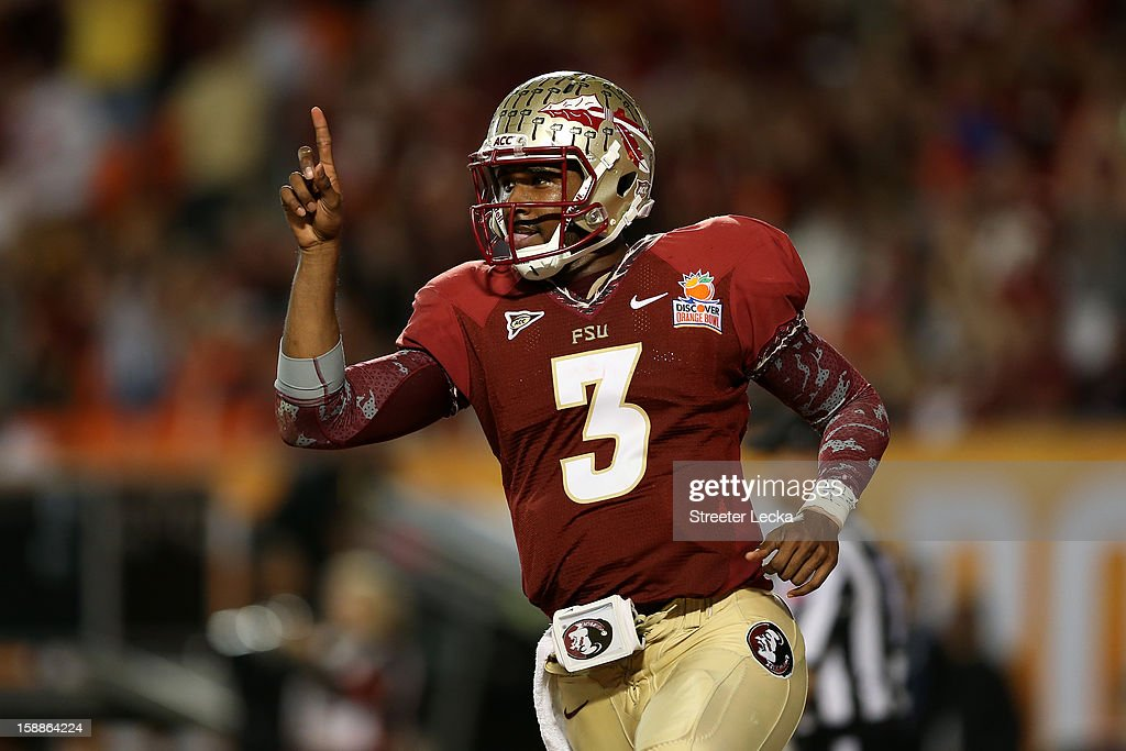 EJ Manuel #3 of the Florida State Seminoles celebrates after he scored a 9-yard rushing touchdown in the fourth quarter against the Northern Illinois Huskies during the Discover Orange Bowl at Sun Life Stadium on January 1, 2013 in Miami Gardens, Florida.