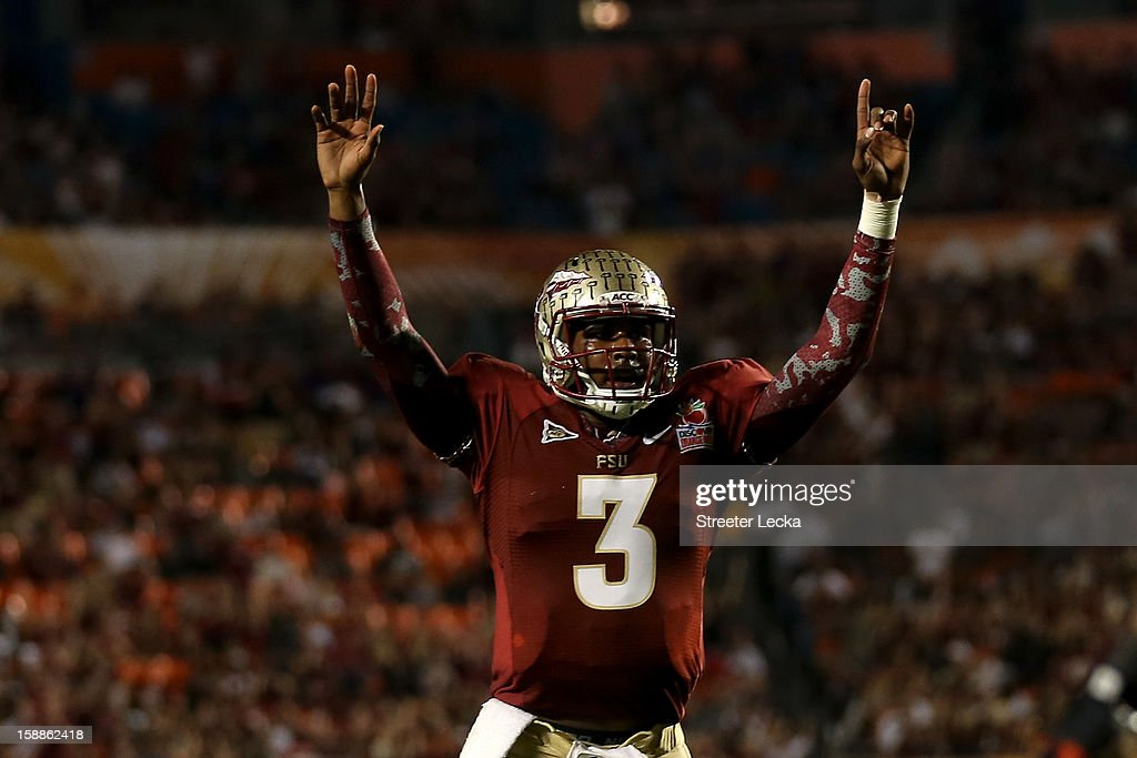 EJ Manuel #3 of the Florida State Seminoles celebrates after he threw a 6-yard touchdown pass to Rashad Greene #80 in the second quarter against the Northern Illinois Huskies during the Discover Orange Bowl at Sun Life Stadium on January 1, 2013 in Miami Gardens, Florida.