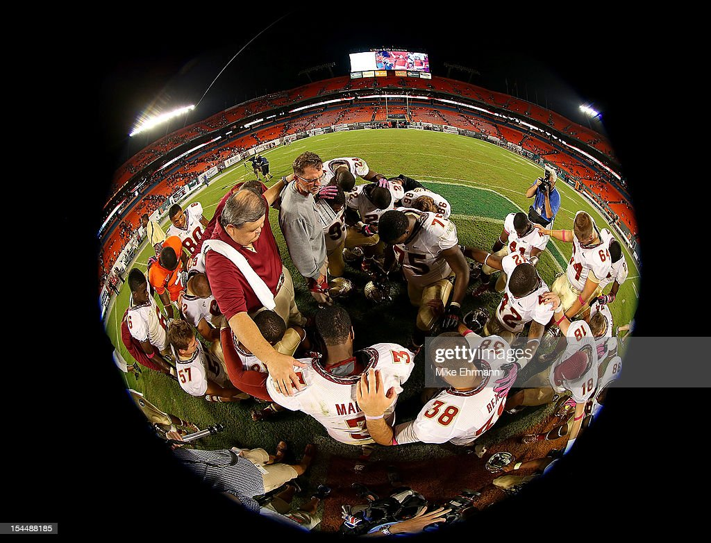 EJ Manuel #3 of the Florida State Seminoles gathers for a prayer after a game against the Miami Hurricanes at Sun Life Stadium on October 20, 2012 in Miami Gardens, Florida.