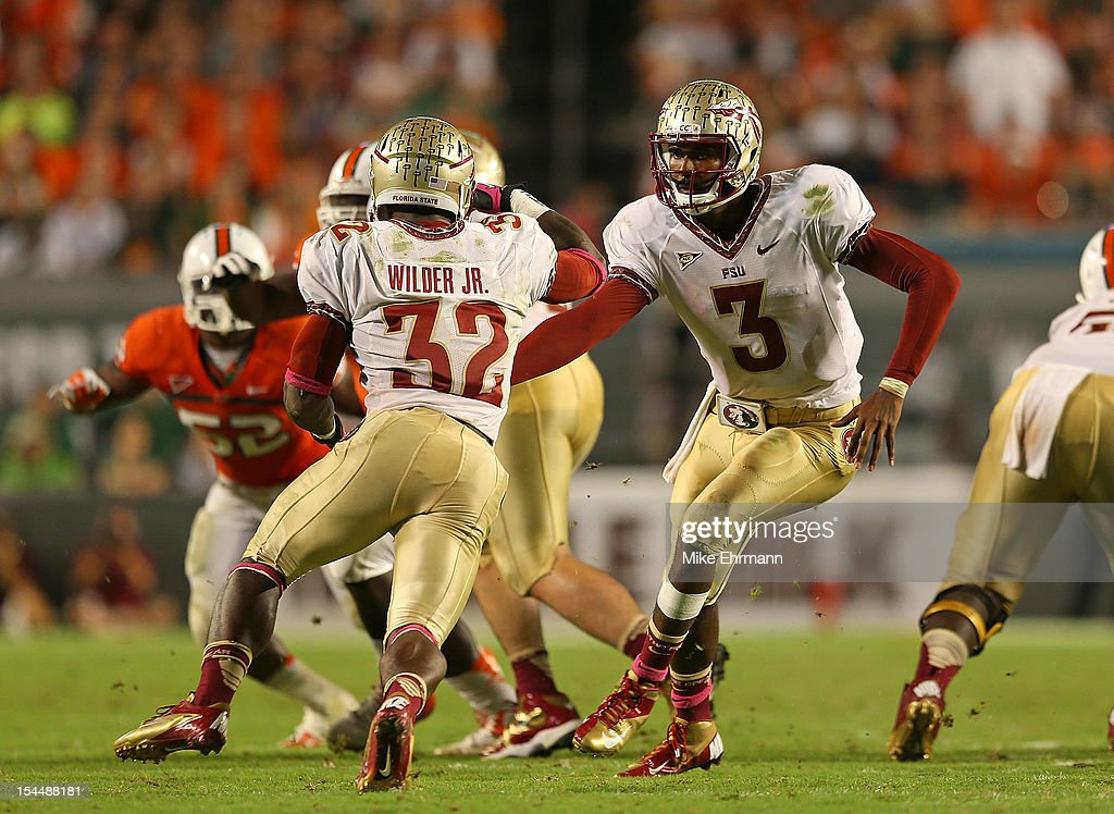EJ Manuel #3 of the Florida State Seminoles hands off to James Wilder Jr. #32 during a game against the Miami Hurricanes at Sun Life Stadium on October 20, 2012 in Miami Gardens, Florida.