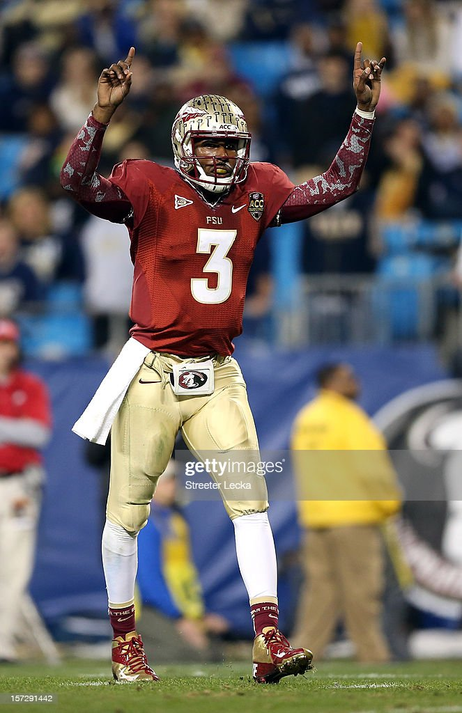 EJ Manuel #3 of the Florida State Seminoles reacts after his team scores a touchdown against the Georgia Tech Yellow Jackets during the 2012 ACC Championship game at Bank of America Stadium on December 1, 2012 in Charlotte, North Carolina.