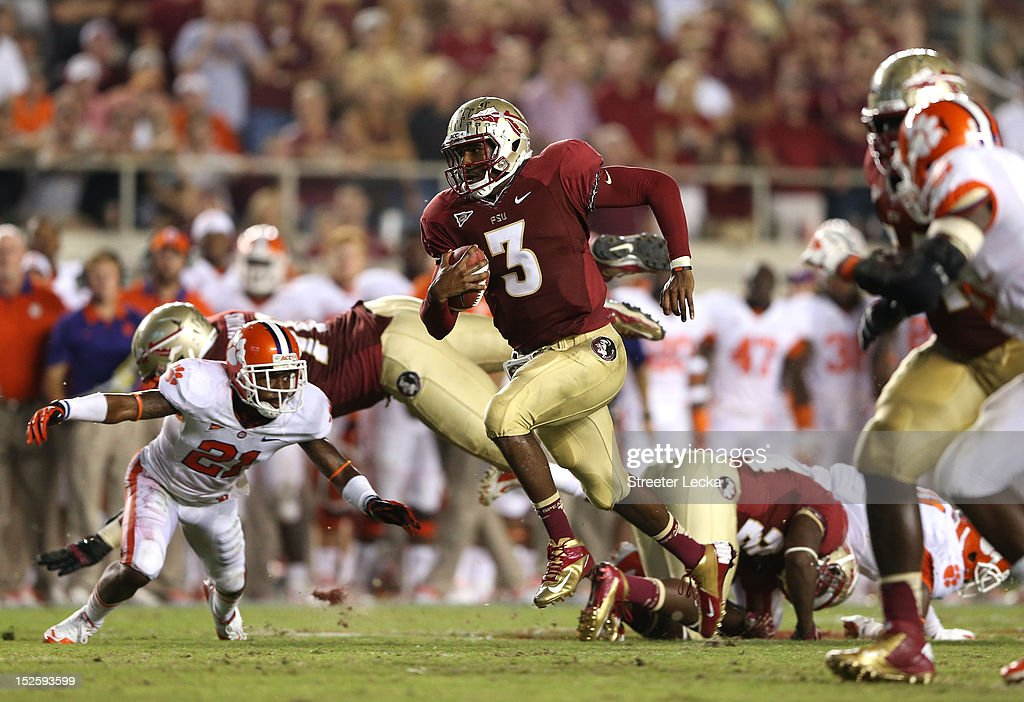 EJ Manuel #3 of the Florida State Seminoles runs with the ball against the Clemson Tigers during their game at Doak Campbell Stadium on September 22, 2012 in Tallahassee, Florida.