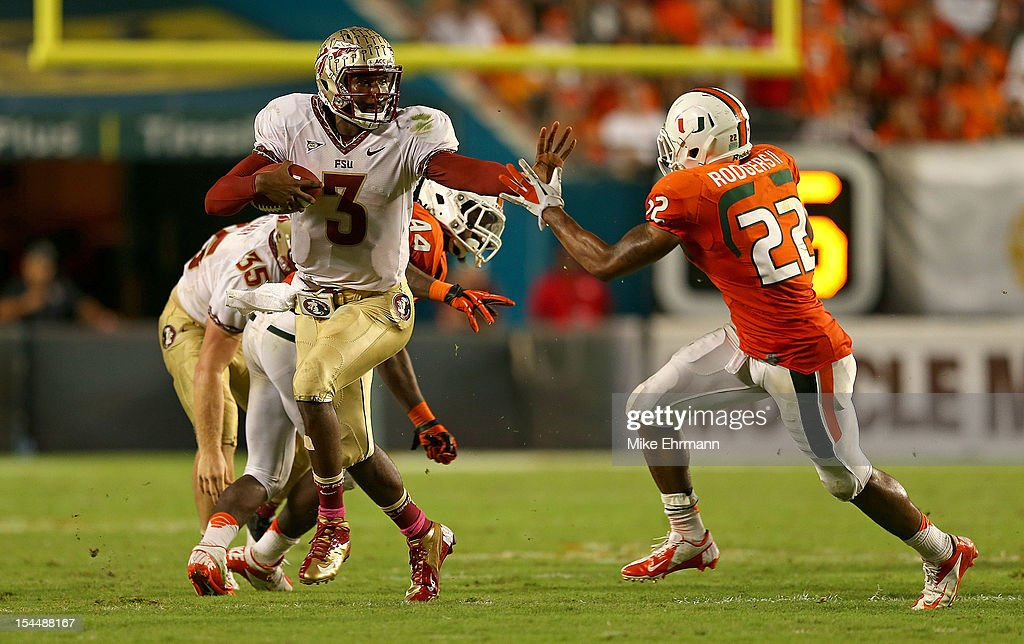 EJ Manuel #3 of the Florida State Seminoles rushes during a game against the Miami Hurricanes at Sun Life Stadium on October 20, 2012 in Miami Gardens, Florida.