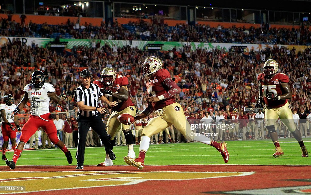 EJ Manuel #3 of the Florida State Seminoles scores a 9-yard rushing touchdown in the fourth quarter against the Northern Illinois Huskies during the Discover Orange Bowl at Sun Life Stadium on January 1, 2013 in Miami Gardens, Florida.