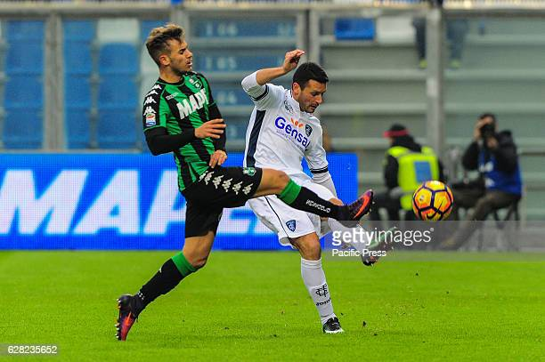 Manuel Pasqual Empoli Football Club's defender and Federico Ricci Sassuolo's forward fight for the ball during the serie A football match between US...