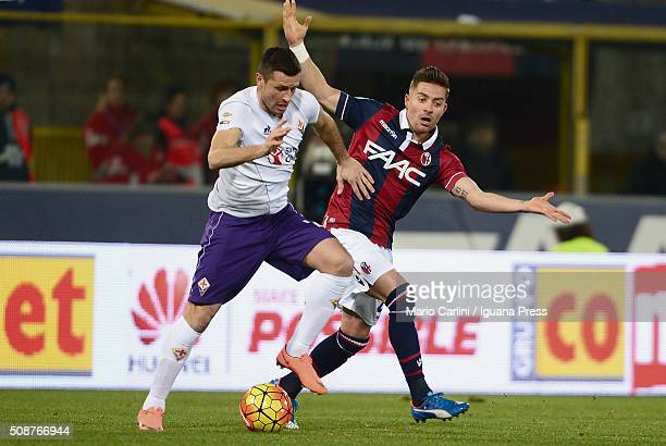 Manuel Pasqual of ACF Fiorentina competes the ball with Anthony Mounier of Bologna FC during the Serie A match between Bologna FC and ACF Fiorentina...