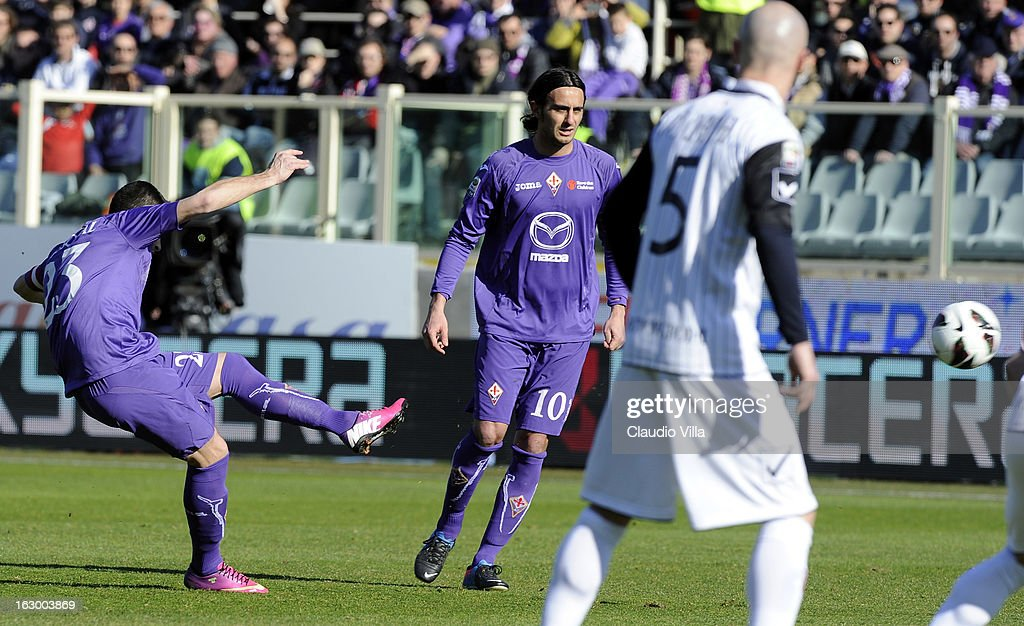 Manuel Pasqual of ACF Fiorentina (L) scores the first goal during the Serie A match between ACF Fiorentina and AC Chievo Verona at Stadio Artemio Franchi on March 3, 2013 in Florence, Italy.