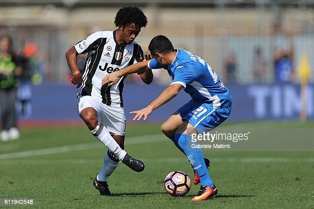 Manuel Pasqual of Empoli FC battles for the ball with Juan Cuadrado of Juventus FC during the Serie A match between Empoli FC and Juventus FC at...