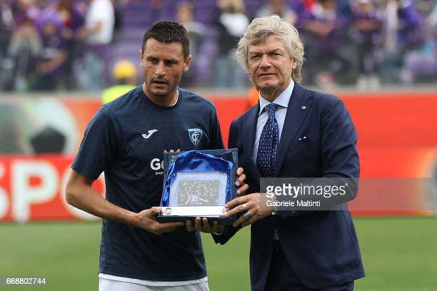 Manuel Pasqual of Empoli FC is presented with an award by Giancarlo Antognoni of ACF Fiorentina during the Serie A match between ACF Fiorentina and...