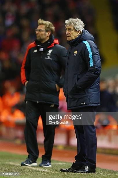 Manuel Pellegrini manager of Manchester City and Jurgen Klopp look on during the Barclays Premier League match between Liverpool and Manchester City...