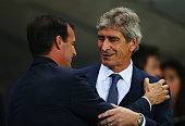 Manuel Pellegrini manager of Manchester City and Massimiliano Allegri manager of Juventus shake hands prior to the UEFA Champions League Group D...