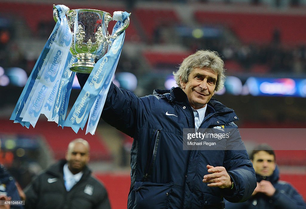 <a gi-track='captionPersonalityLinkClicked' href=/galleries/search?phrase=Manuel+Pellegrini&family=editorial&specificpeople=673553 ng-click='$event.stopPropagation()'>Manuel Pellegrini</a>, manager of Manchester City celebrates victory with the trophy after the Capital One Cup Final between Manchester City and Sunderland at Wembley Stadium on March 2, 2014 in London, England.