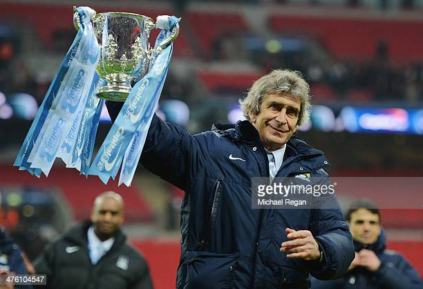 Manuel Pellegrini manager of Manchester City celebrates victory with the trophy after the Capital One Cup Final between Manchester City and...